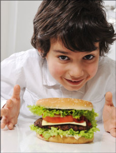 Child with a big bison burger