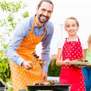 Father and daughter having a barbecue