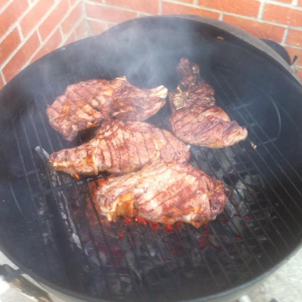 turn bison steaks to cook side 2