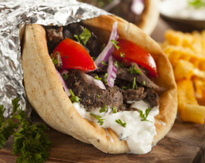 wild boar souvlaki with tomato onion and tzitiki