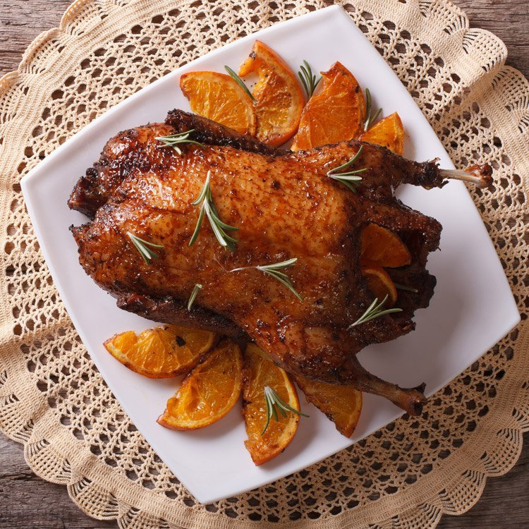 roast duck with orange slices