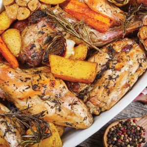 Roast rabbit with herbs and carrots