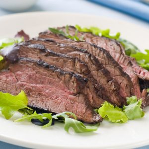 ostrich steak sliced on a bed of lettuce