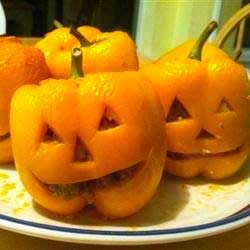 mini stuffed peppers in the shape of a jack o lantern . Fun recipes for Halloween  pre trick or treat dinner