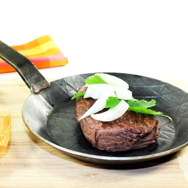 ostrich steak in fry pan