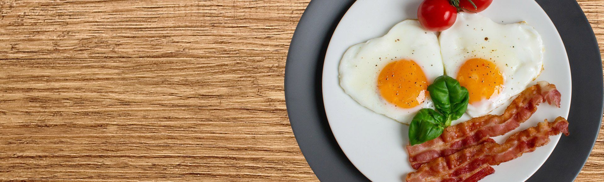 heart shaped eggs on a plate with baco